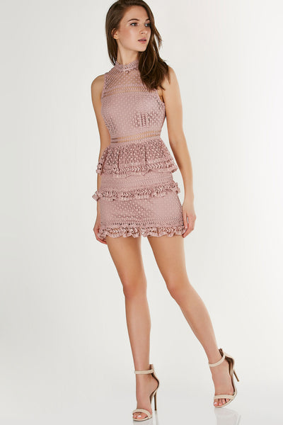 Mock neck sleevless crochet dress with tiered ruffled details and lining across chest and skirt.