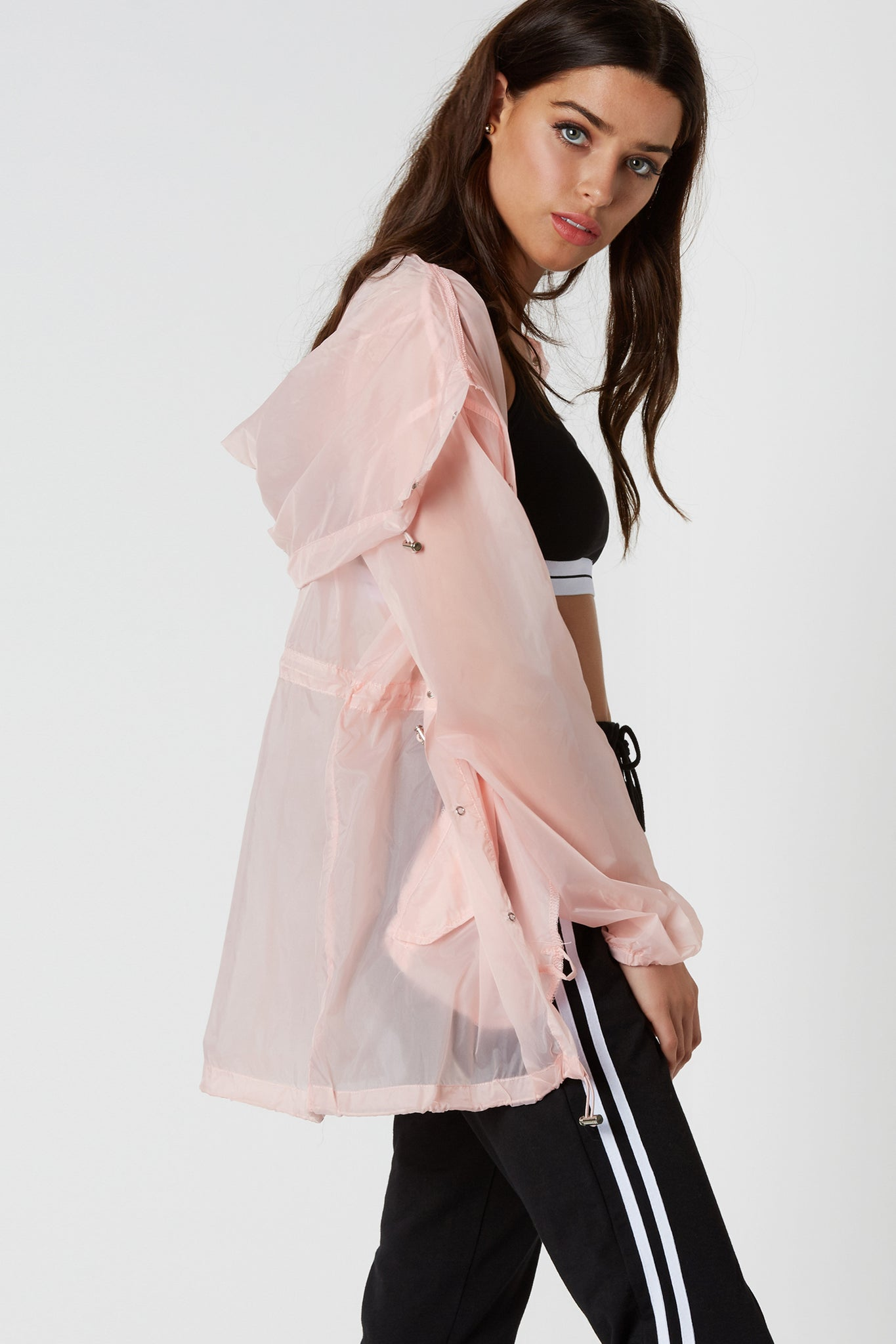 Fun lightweight anorak style jacket with snap button closure and drawstring detailing at waist.