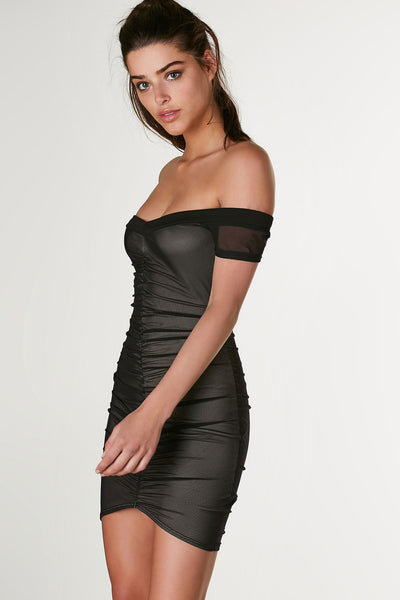 Sexy off shoulder mini dress with nude lining and mesh exterior. Ruched down the center in both front and back with stretchy bodycon fit.