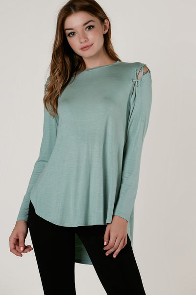 Crew neck oversized long sleeve top with lace up cold shoulder design. Soft material with hi-low longline hem and side slits for added detail.