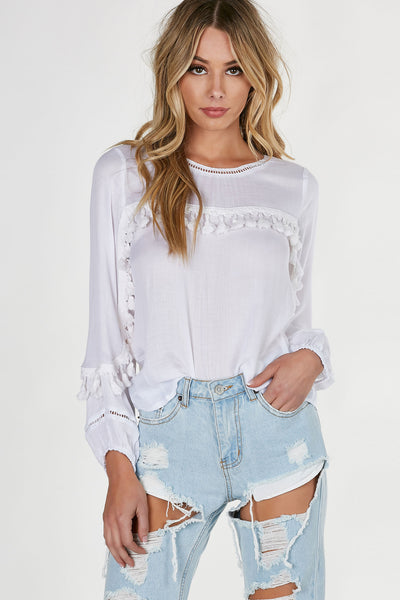 Flowy lightweight blouse with tassels across the front and sleeves. Crochet detailing with straight hem all around.