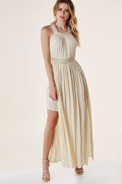 Sleeveless maxi dress with high neckline. Crochet detailing with open back and bold side slits.