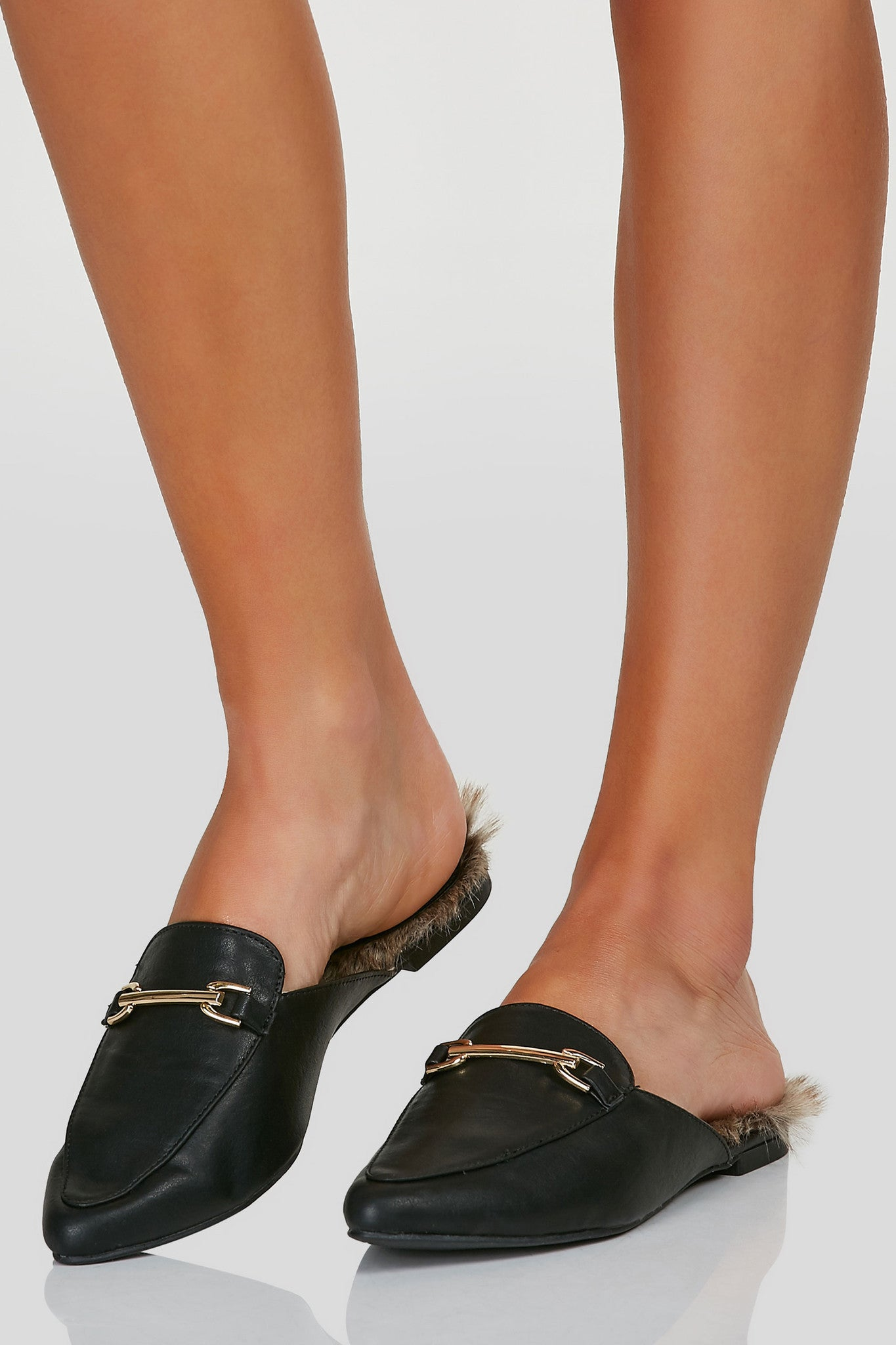 A chic pair of pointed toe loafers with gold hardware buckle detailing. Designer inspired faux fur lining.