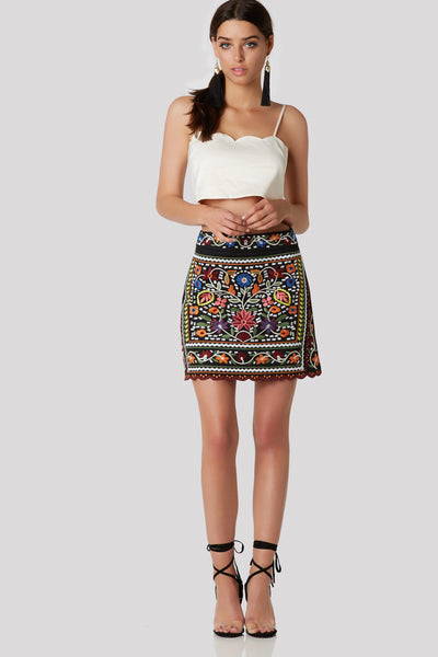 Bold high rise mini skirt with colorful embroidery. Fully lined with hidden back zip closure and scalloped hem finish in front.
