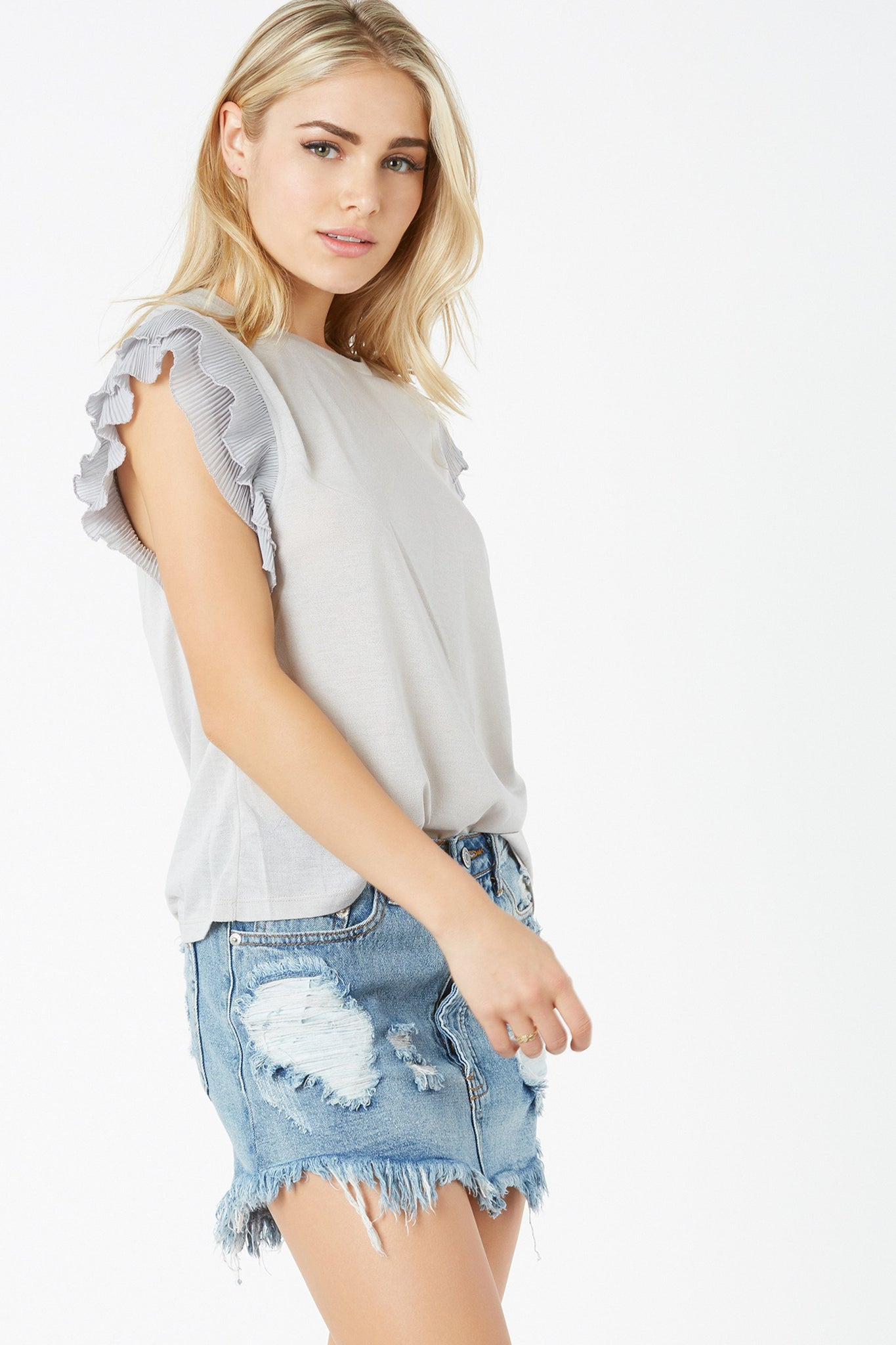 Chic crew neck top with relaxed fit. Lightweight material with tiered pleated sleeves for added detail.
