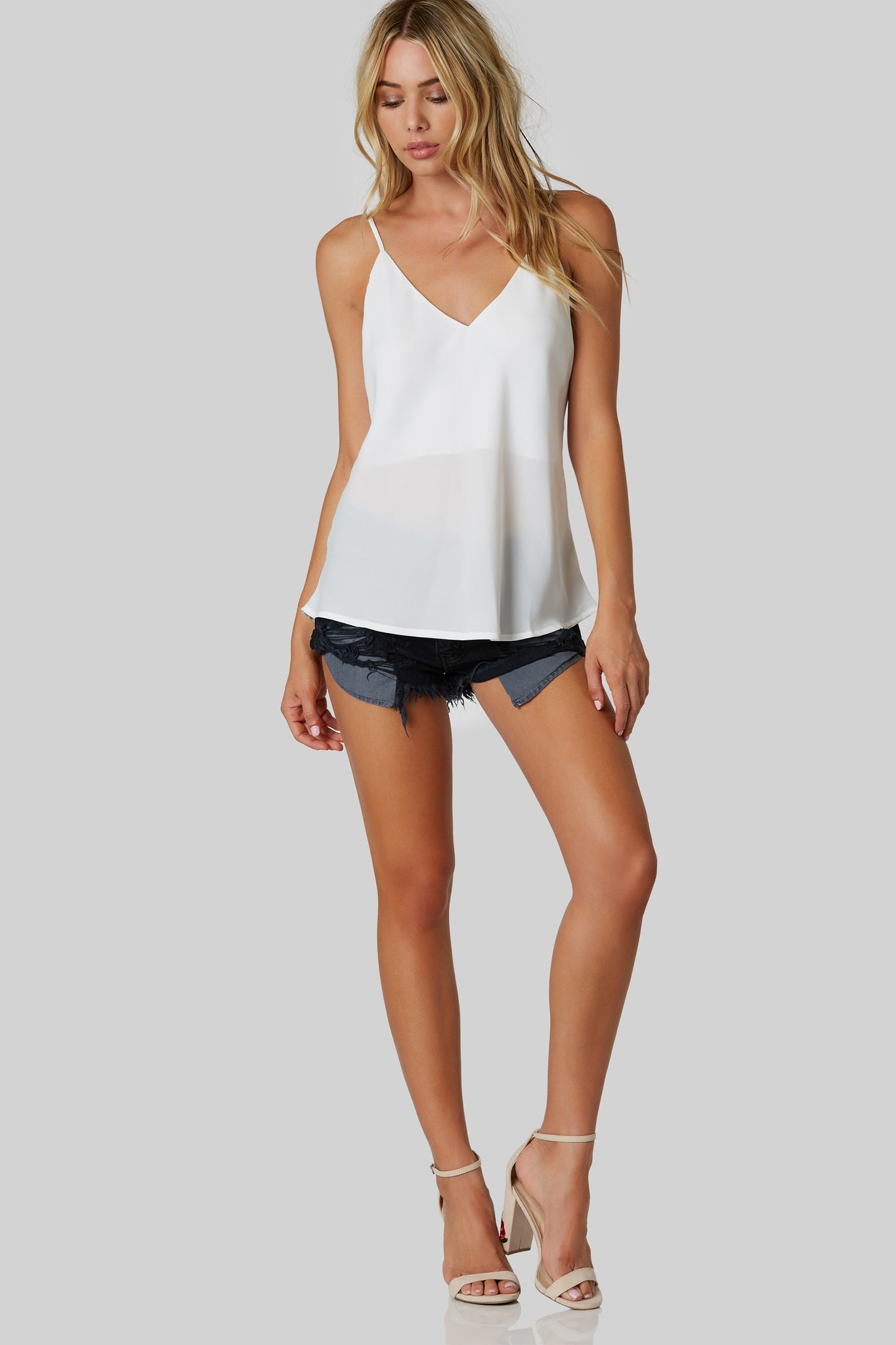 Basic V-neck cami with criss-cross design in back. Oversized fit with slightly curved hem.