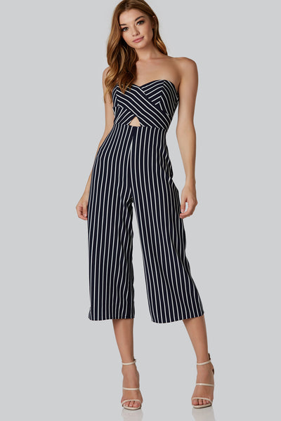 Tube jumpsuit with sweetheart neckline and cut out detail in front. Cropped hem padded breasts inner lining and zipper closure at back.