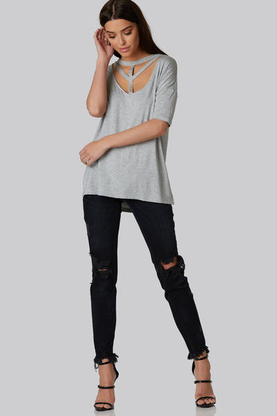 Oversized tunic with front strappy detail, plunging scoop neck, and slit side seam.