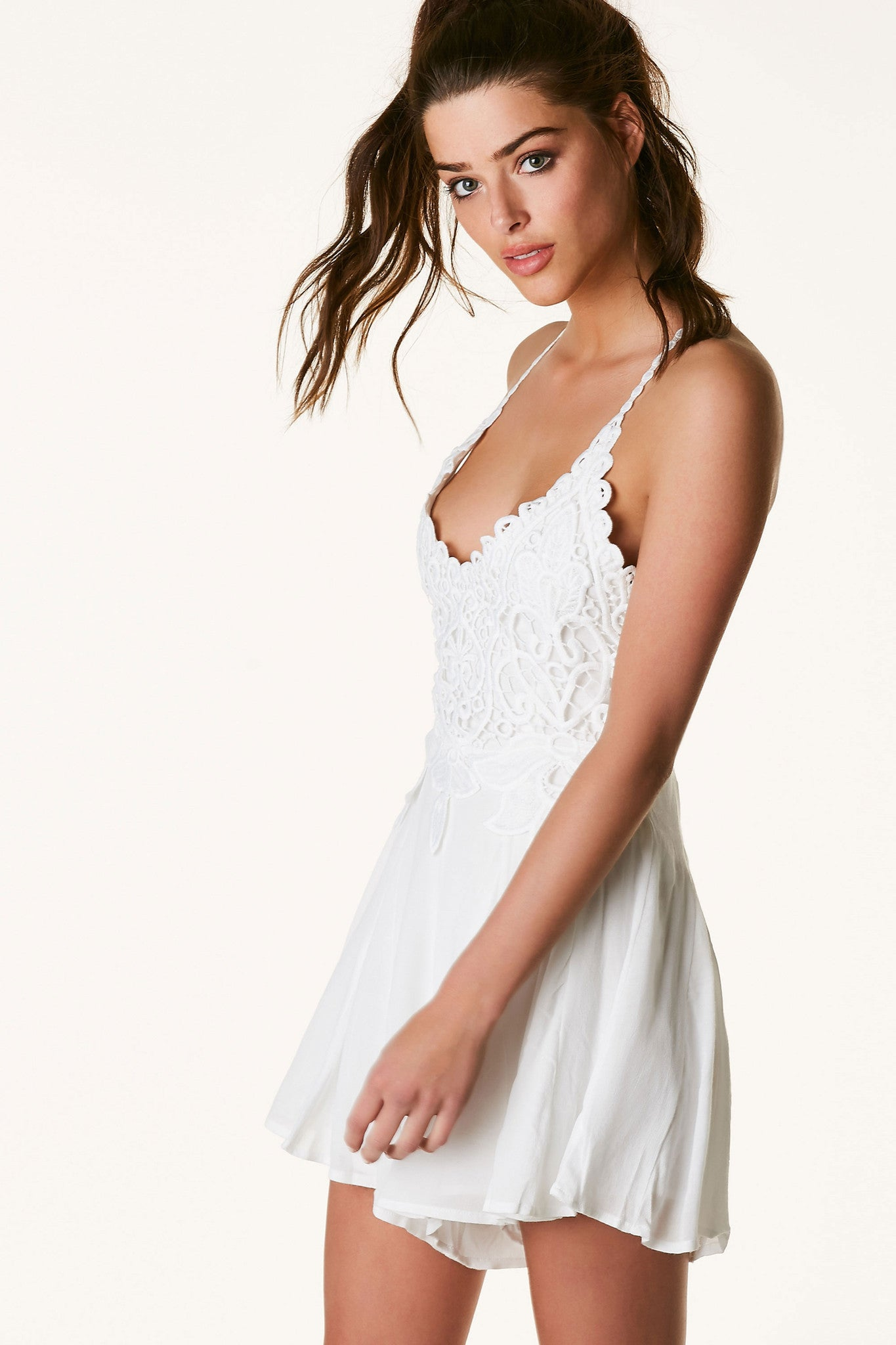 Strappy V-neck romper with contrast crochet detailing at top. Fully lined with open back with ties for closure.