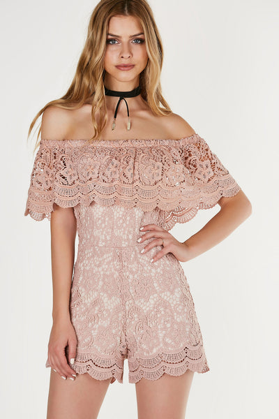 Gorgeous off shoulder romper with nude lining and intricate crochet overlay. Tiered design with back zip closure.