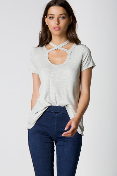 Casual short sleeve ribbed top with rounded neckline and strappy design. Relaxed fit with straight hem finish.
