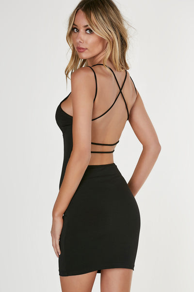 V-neck sleeveless dress with strappy detailing and open back. Form-fitting, slinky material with straight hem all around.