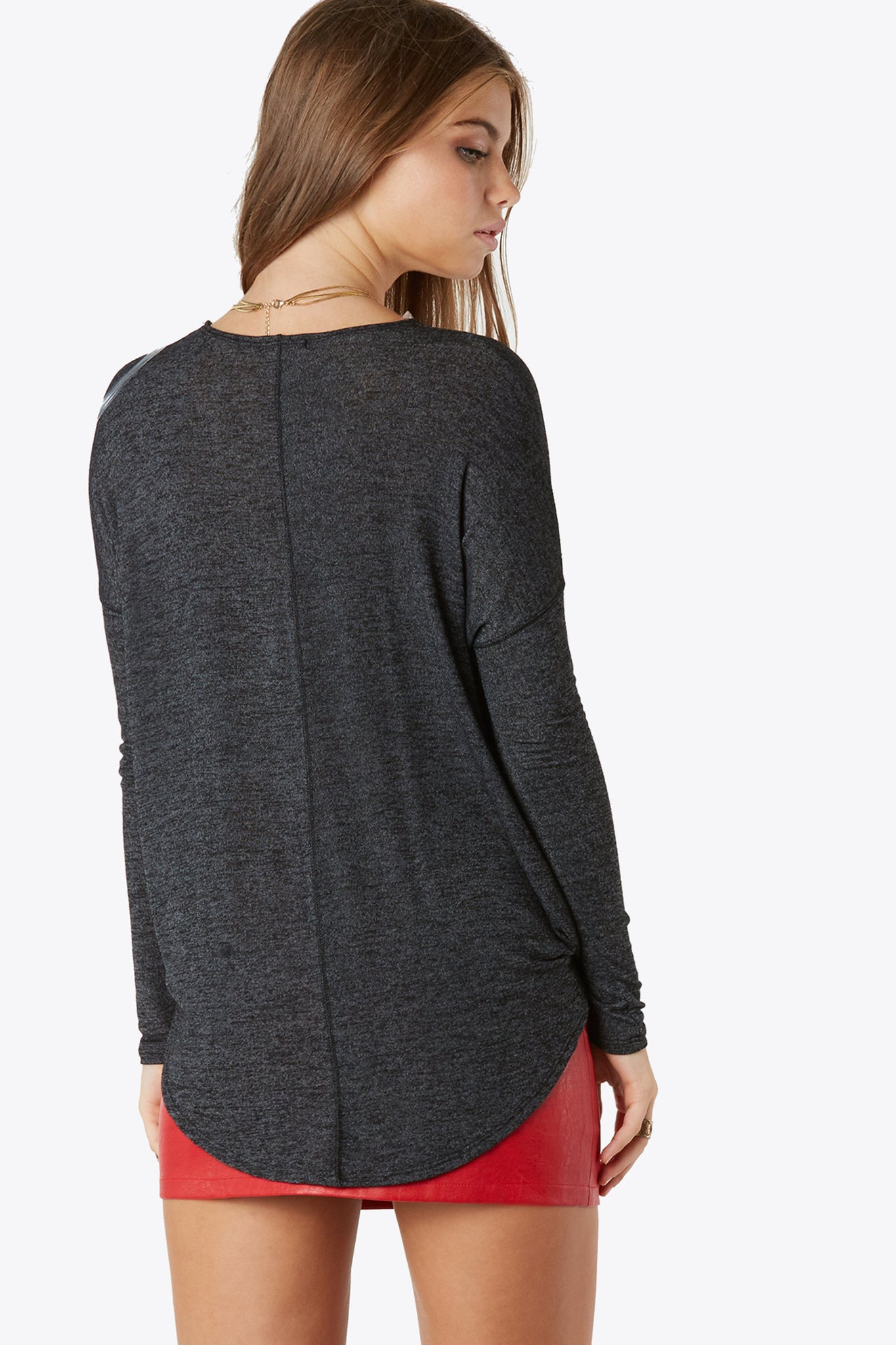 Light-weight long sleeve v-neck. Features a cross front detail for tiered effect.
