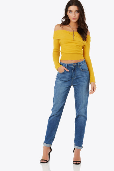Rock your favorite pair of girlfriend jeans that features an adjustable cuff and mid-rise waist.