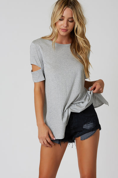 Comfortable oversized T-shirt with slit sleeves. Crew neckline with open back.