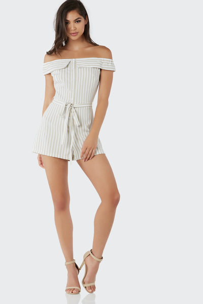 Chic off shoulder romper with faux button detailing down the front. Stripe patterns throughout with waist tie detailing.