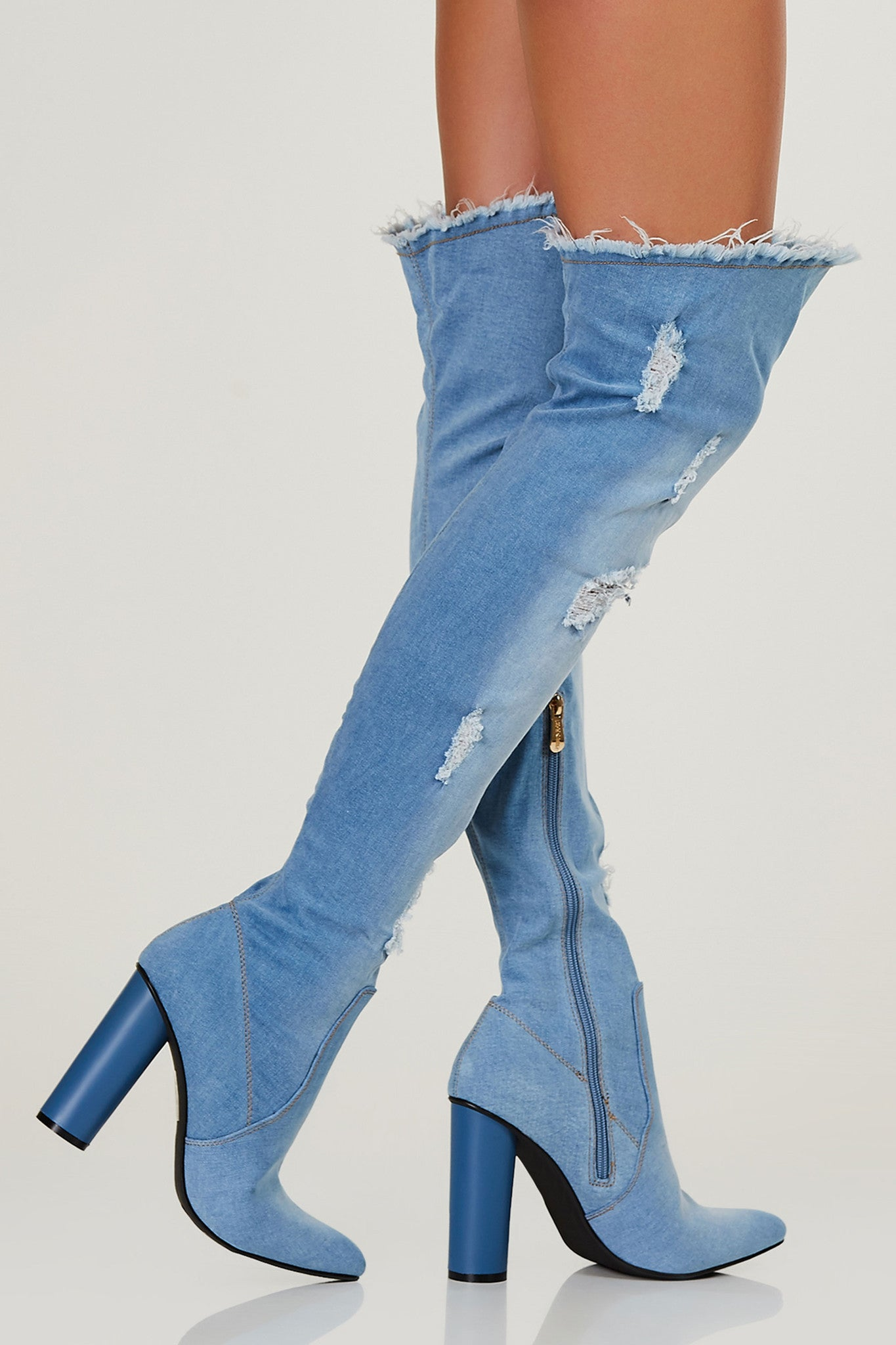 Denim thigh hight boots with chunky block heels. Distressed throughout with inner zip closure.