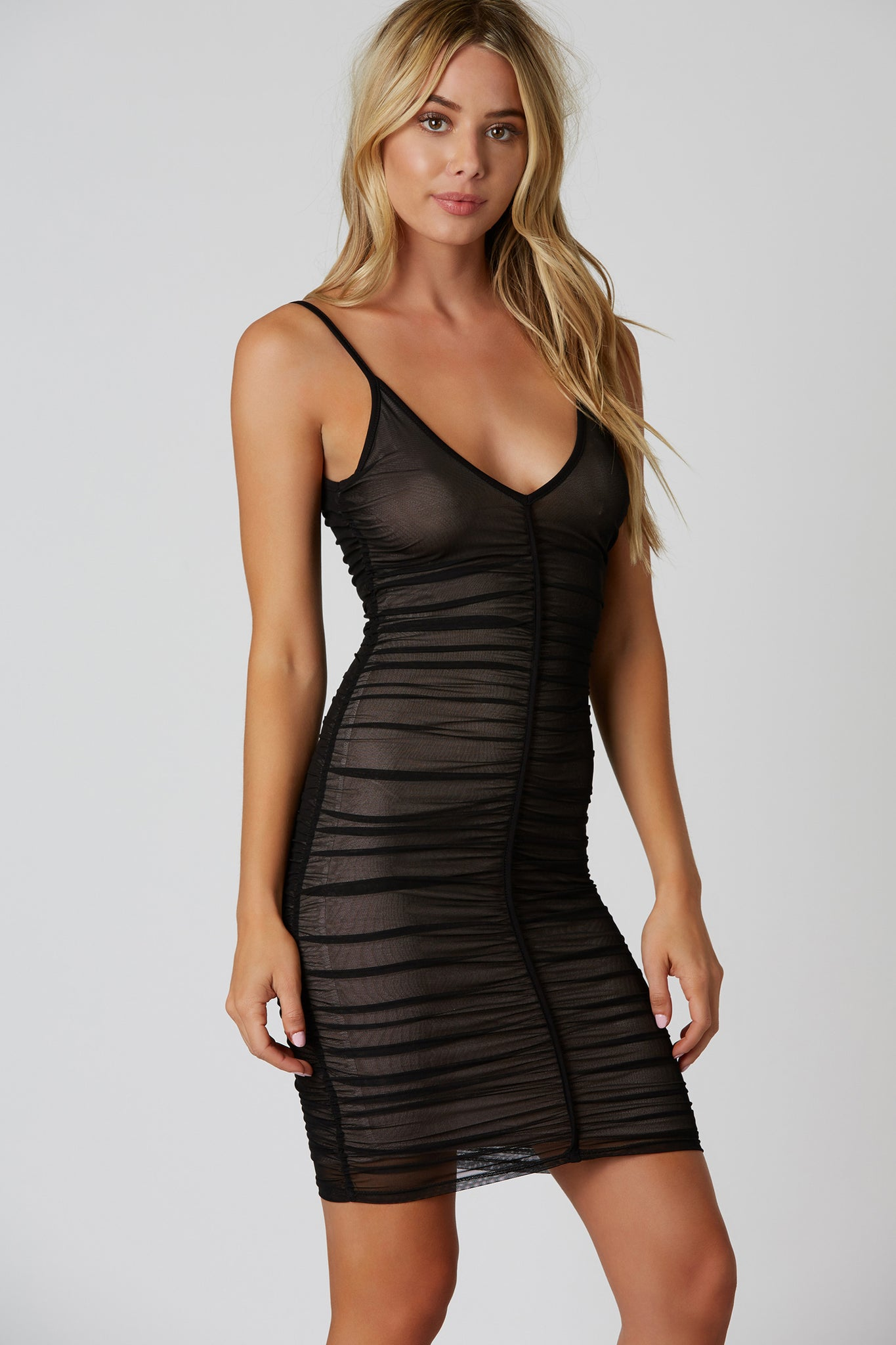 Thin strap v-neck ruche dress with nude lining.