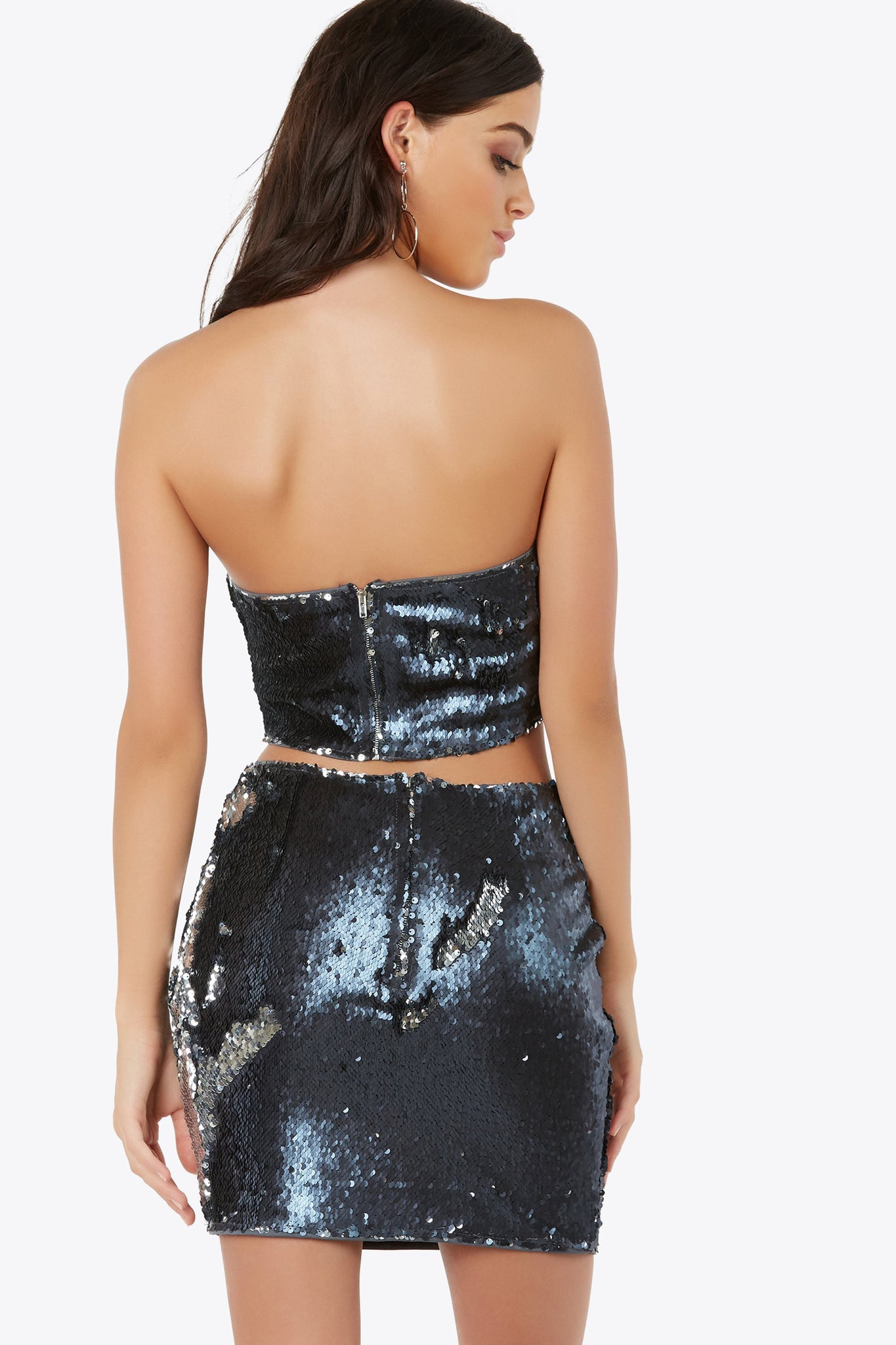Strapless tube crop top with stunning sequin exterior all around. Fully lined with padding at bust and back zip closure.