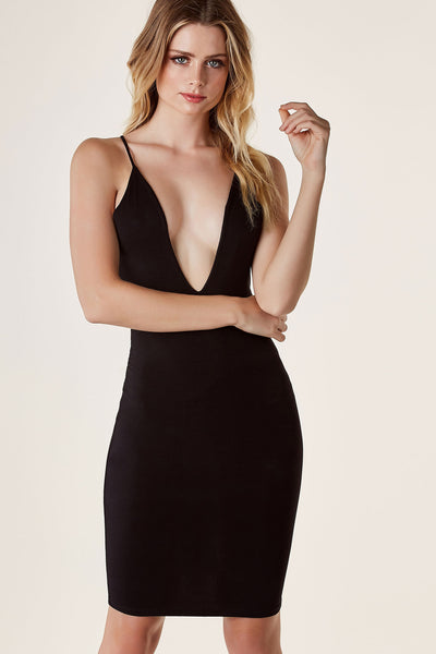 Sexy sleeveless bodcon dress with deep V-neckline. Racer style back with cut outs and caged design with gold eyelet detailing.