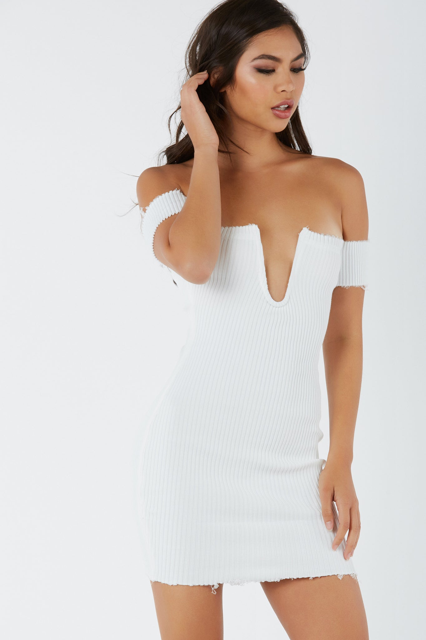 Sexy off shoulder mini dress with qired plunge at neckline. Ribbed throughout for amazing stretch and raw hem finish all around.