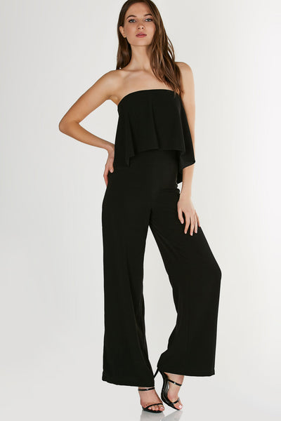 Chic strapless jumpsuit with tiered design and wide leg fit. Cut out back with strappy detailing and hook and eye clasp closure.
