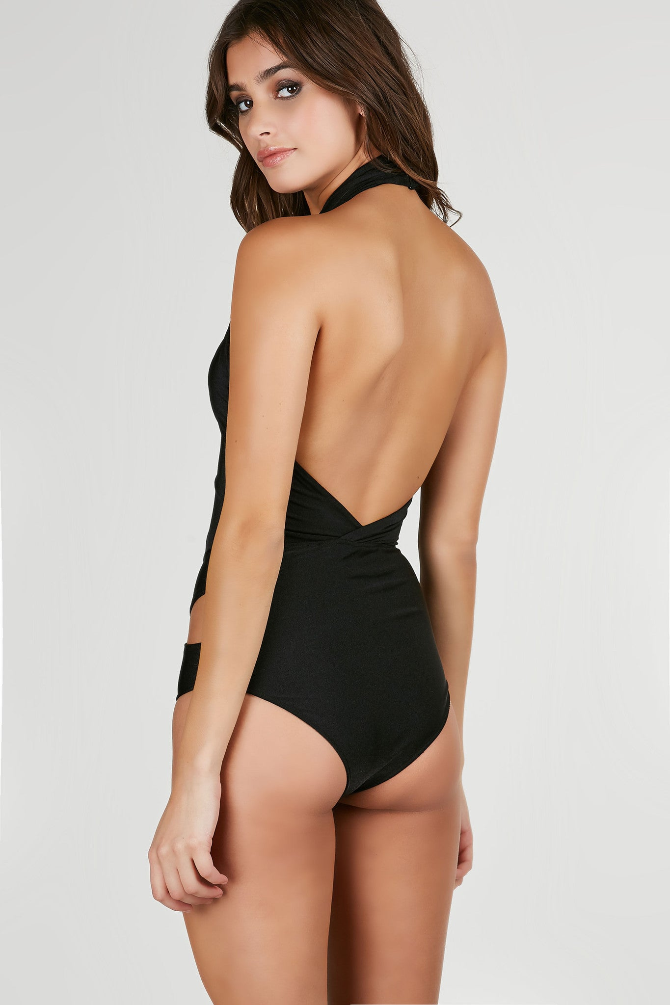 Halter bathingsuit with chic twist detailing and cut outs throughout. Open back with cheeky cut.