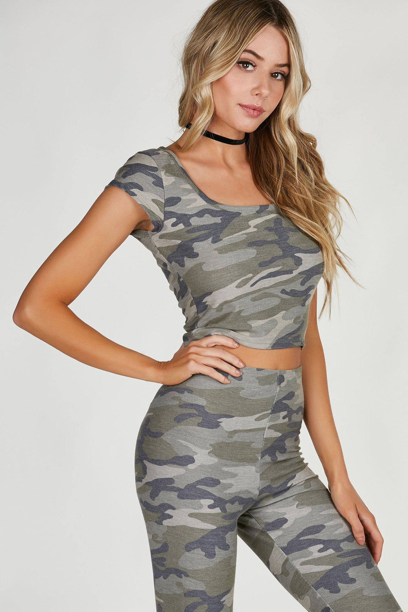 Scoop neck crop top with cap sleeves. Camo print throughout with straight hem finish. Comes in a set with matching bottoms sold separately.