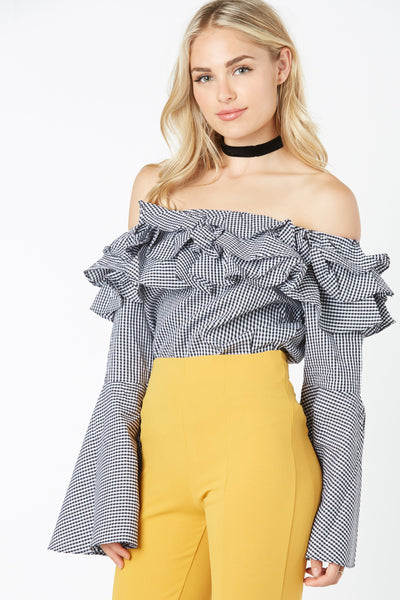 Flirty off shoulder top with ruffle trim detailing. Bell sleeves with relaxed fit.