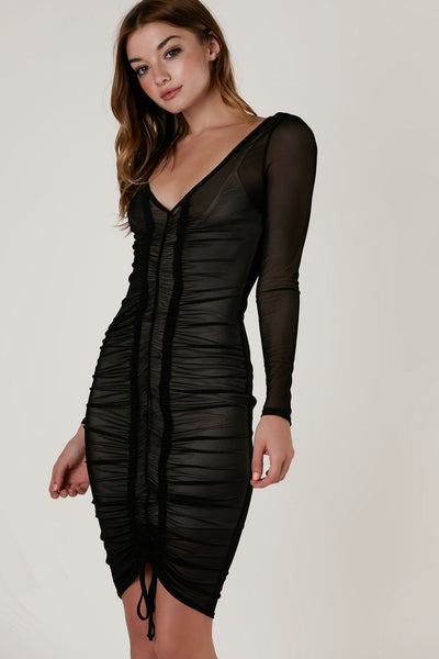 Sexy long sleeve bodycon dress with nude lining and sheer mesh exterior. Flattering V-neckline with ruching down the center in front and adjustable drawstring at hem.