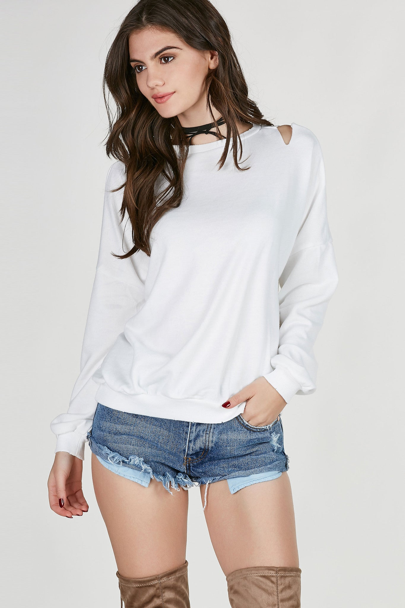 Crew neck long sleeve sweatshirt with distressing throughout. Dropped shoulder seams with oversized fit.
