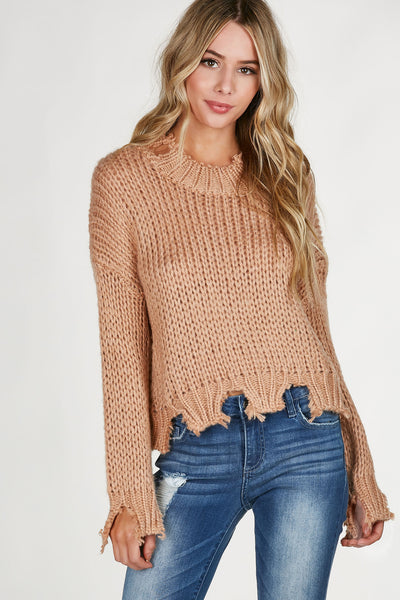 High neck loose knit sweater with long sleeve and oversized fit. Heavily distressed all around with cropped hem.