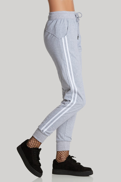 Trendy casual joggers with contrast stripe patterns on each side. Comfortable drawstring waist and ribbed hem finish.