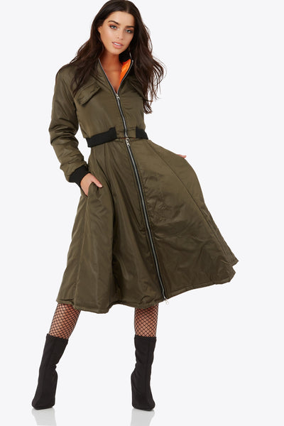 Bundle up in a 2-in-1 bomber that can be styled as a dress, coat, 2-piece set or even worn separately! Completely detachable jacket and skirt. Features metal zipper closures with hidden zipper to detach top & bottom piece. Front coat pockets on skirt only.