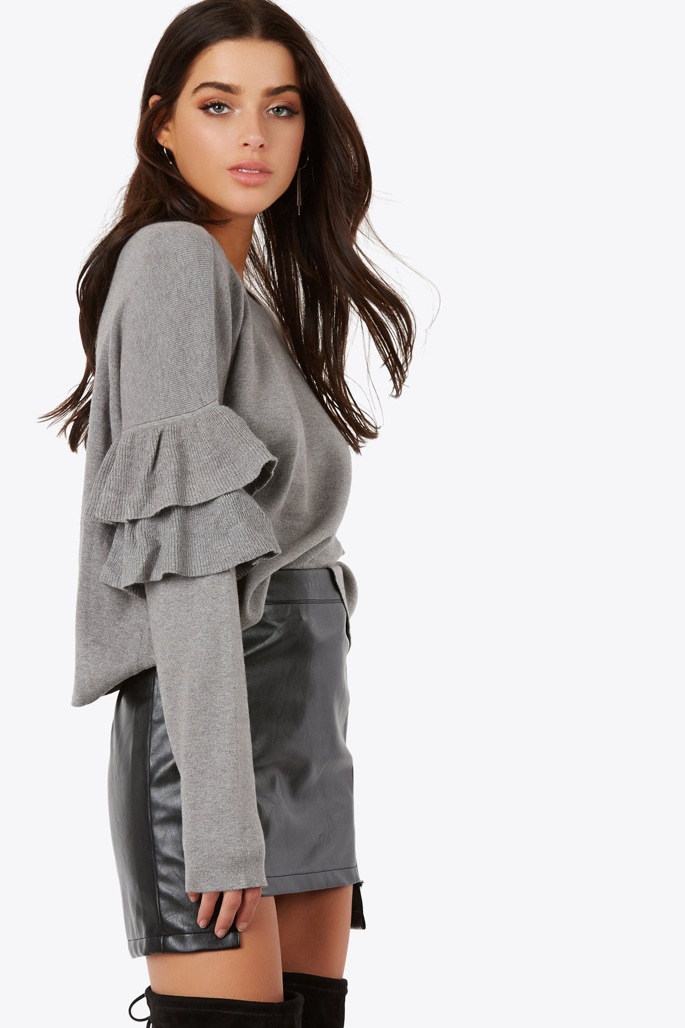 A flare added to your knits with long sleeve top with ruffle accents on sleeves. Has a crew neckline and continuous hem.