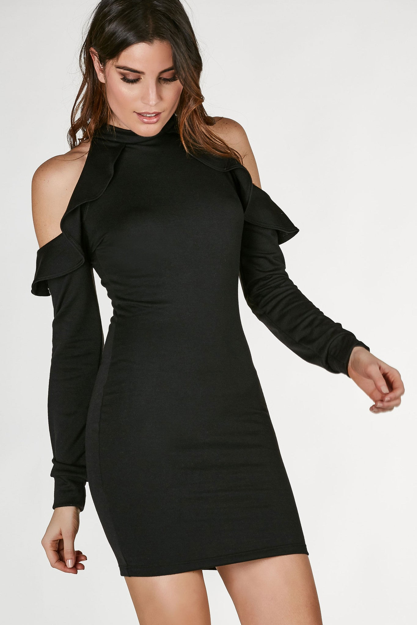 Basic long sleeve dress with a twist. Mock neck with cold shoulder cut outs and flirty ruffle trim for added detail.