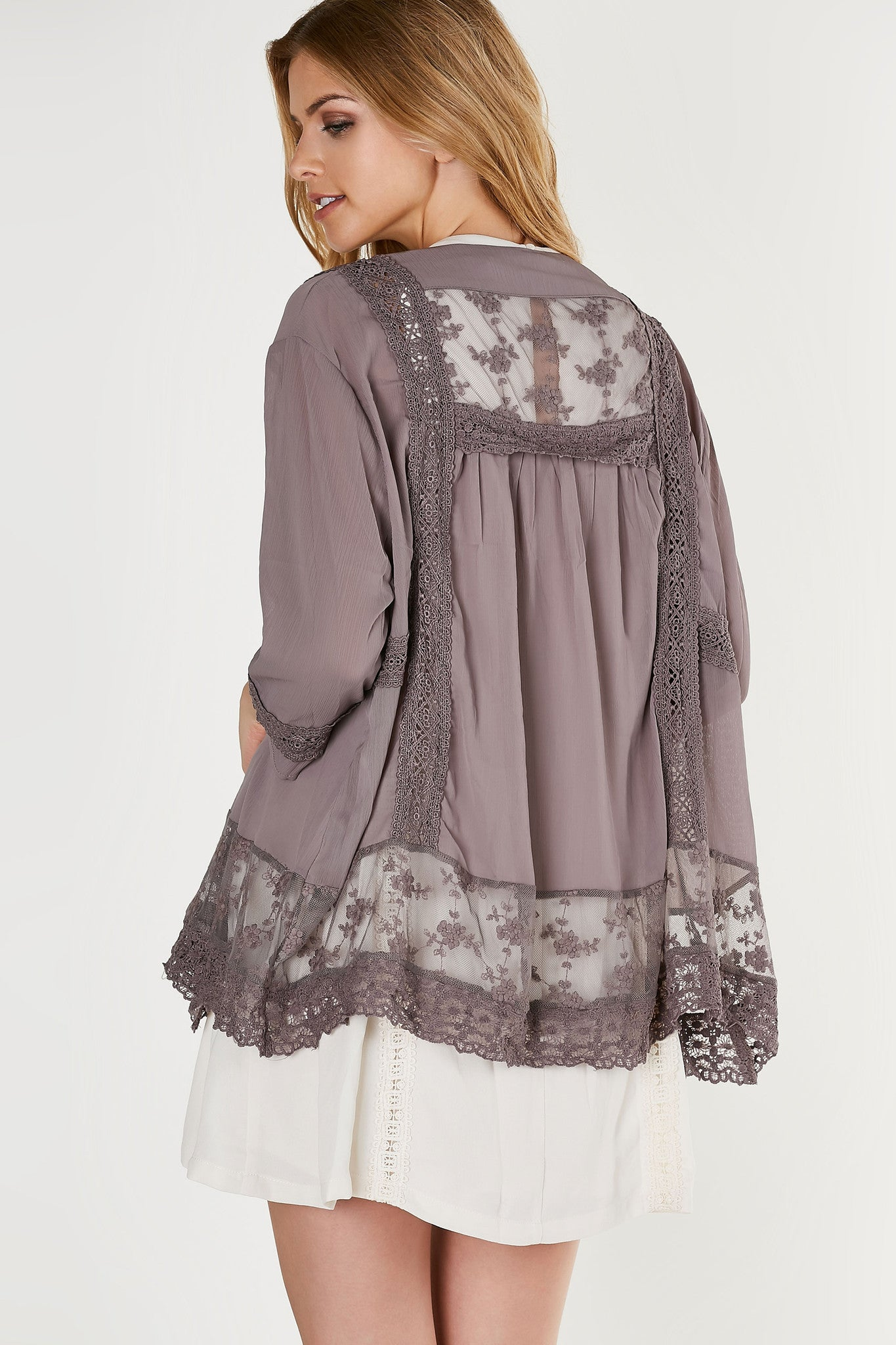 Flowy oversized kimono with intricate lace and crochet detailing.