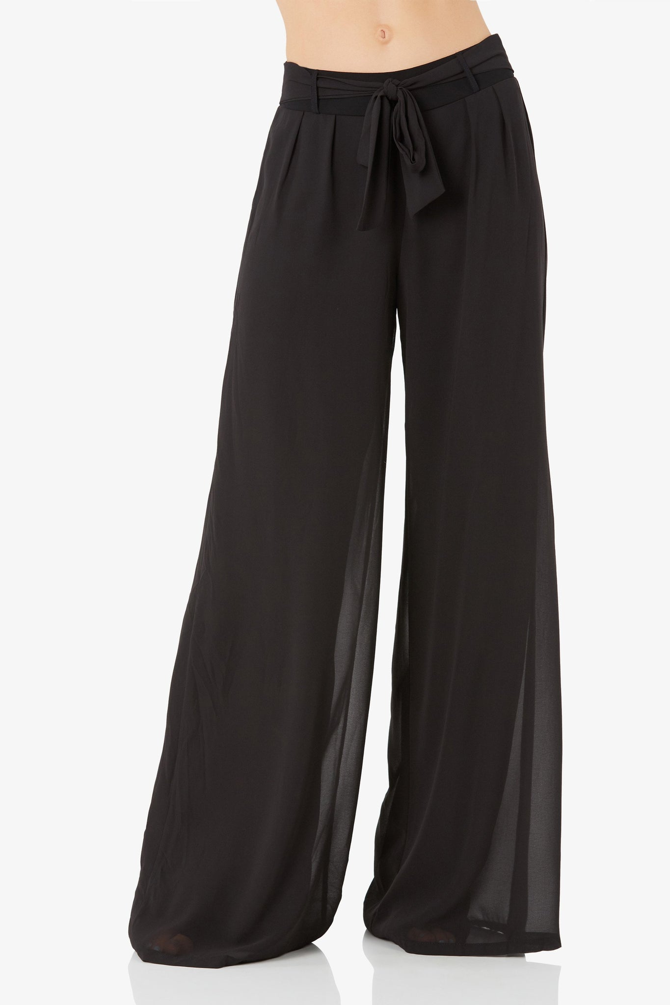 Chic high rise chiffon pants with elasticized waist and tie detailing. Wide leg fit with straight hem finish.