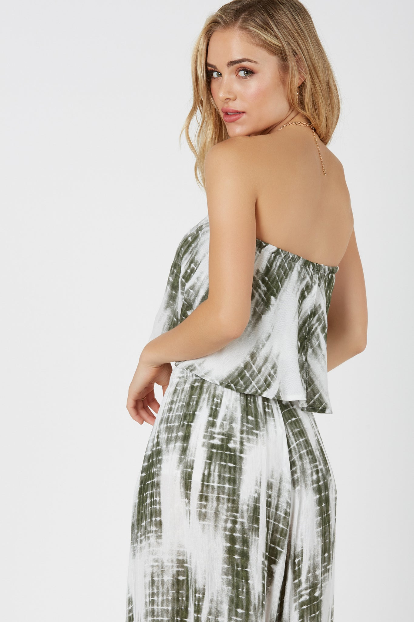 Strapless tiered tube top with tie-dye pattern throughout. Elasticized hem with comfortable stretch for fit.