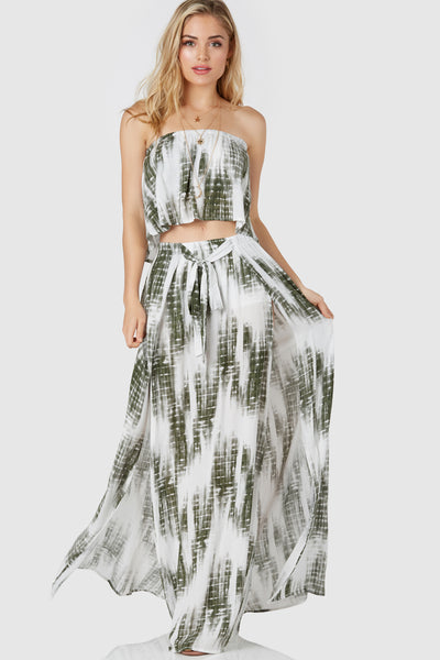 Flowy high rise maxi skirt with tie-dye print throughout. Faux drawstring design with comfy elasticized waist. Bold sits with lined shorts for coverage.
