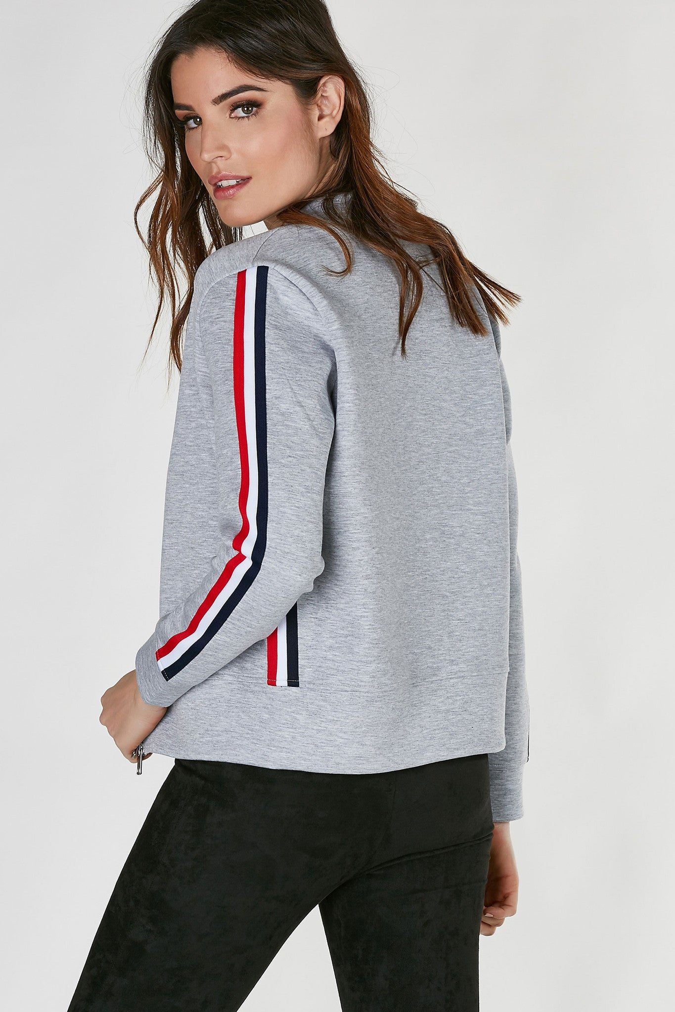 A structured front zip jacket with colorblock stripes on sides. Angled neckline with straight hem all around.