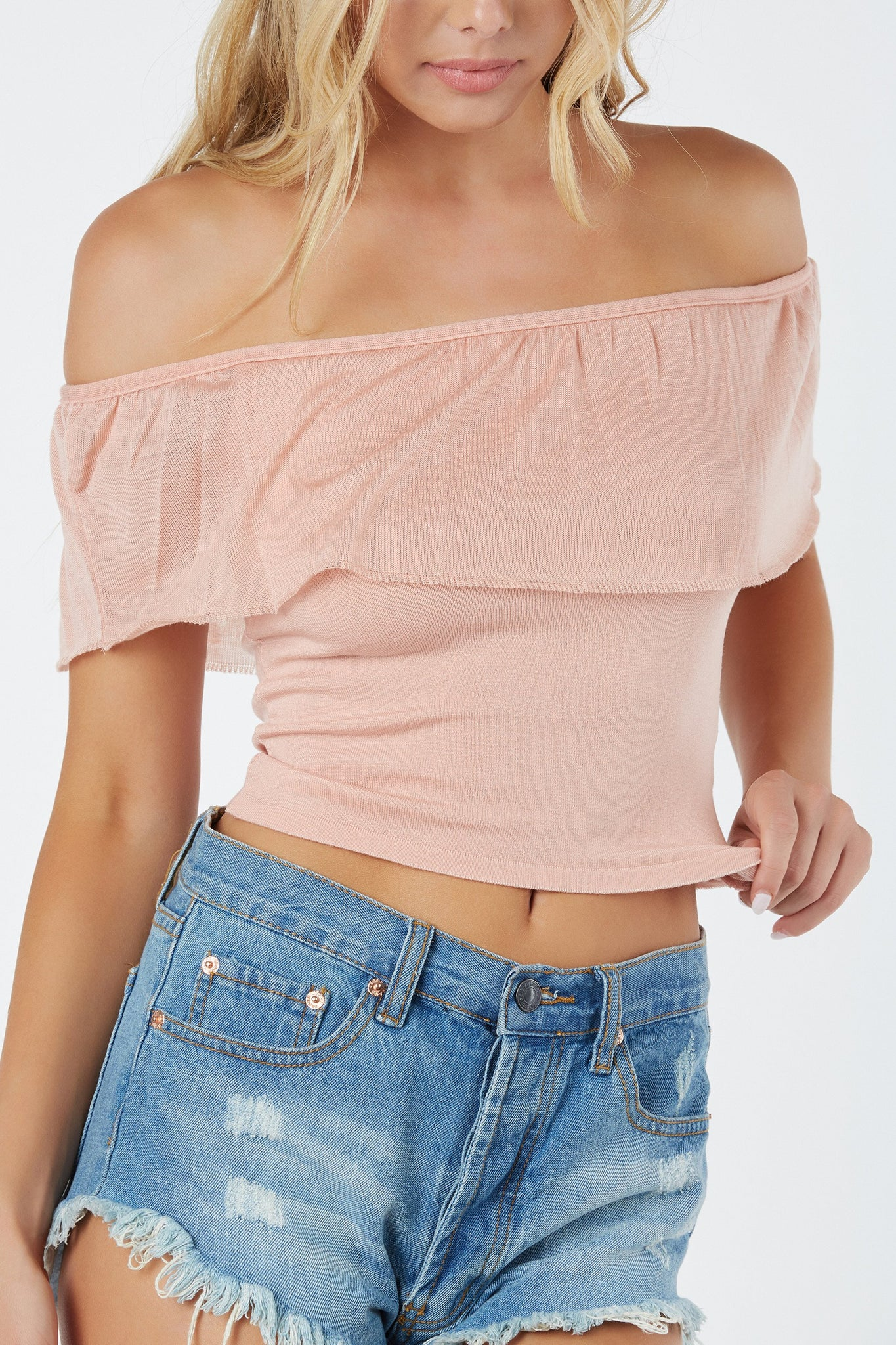 Tiered off shoulder top with sheer overlay. Stretchy material with straight hem finish all around.