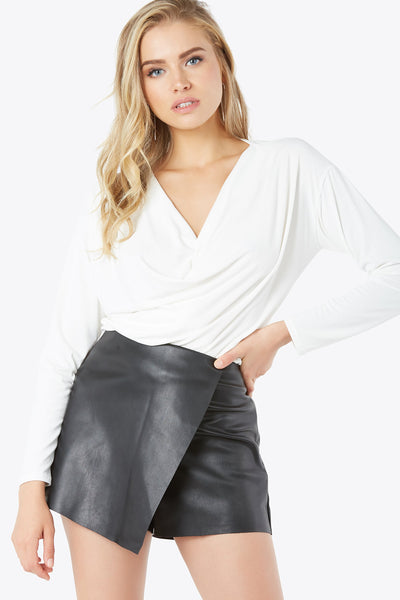 V-neck blouse in soft material. Long sleeves with draped front detailing.