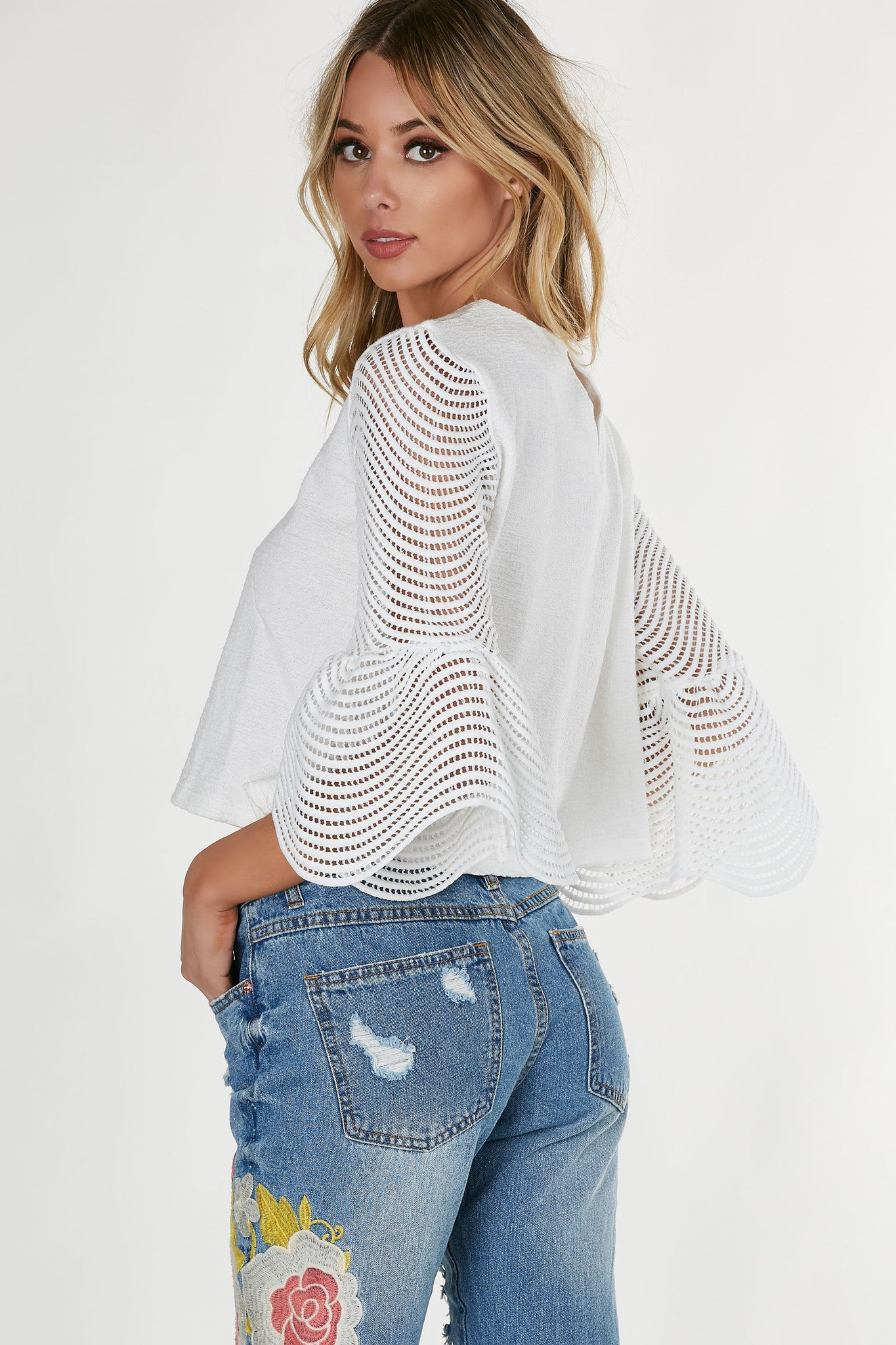 Boxy oversized top with intricate crochet bell sleeves. Crew neck wth straight hem all around.