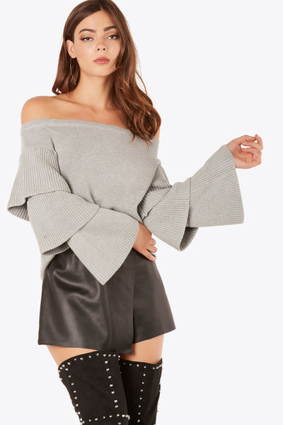 Chic off shoulder sweater top with tiered design at sleeves. Relaxed fit with straight hem finish.