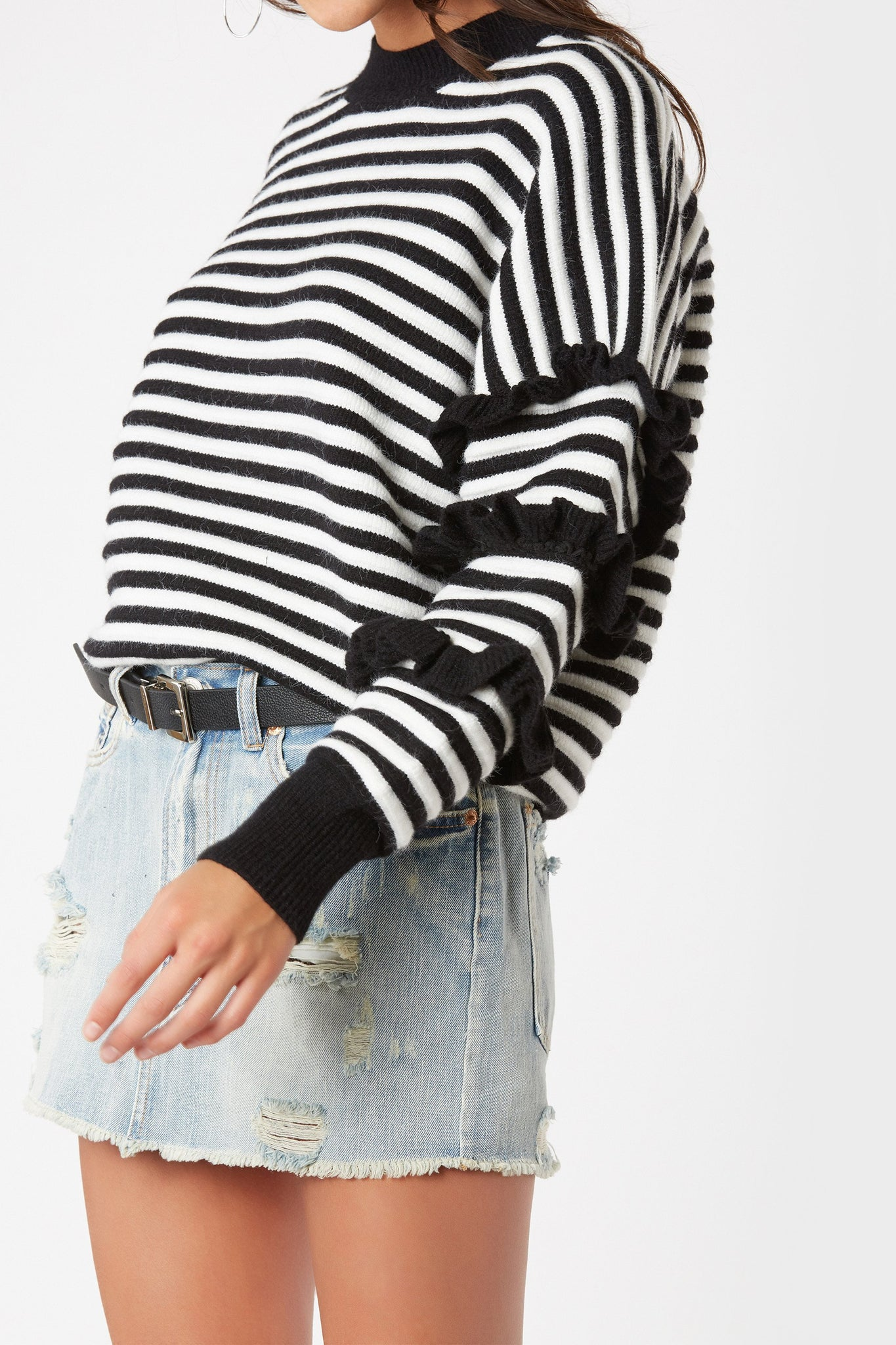 Cozy crew neck sweater with oversized fit. Stripe pattern throughout with ruffle trim detailing on sleeves.