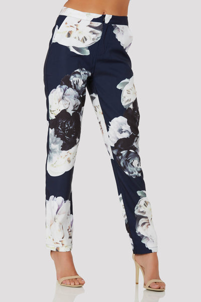 Chich high waisted pants with floral patterns trhoughout. Side pockets and front zip and hook for closure.