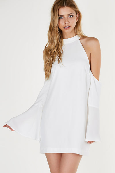 Mock neck dress with bold cold shoulder cut outs and bell sleeves. Flowy fit with hidden back zip closure.
