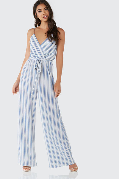 Printed sleeveless jumpsuit with V-neckline and waist tie detailing. Stripe patterns throughout with wide leg fit.