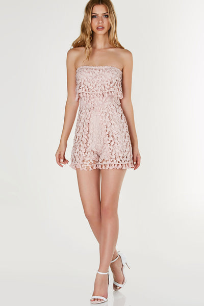 Flirty tube romper with full lining and crochet overlay. Tulip style hem with tassel detailing throughout and back zip closure.